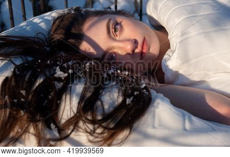Portrait Of An Attractive, Young, Sexy, Seductive Dark Brown Haired Woman In Bed, Winter Snowflakes