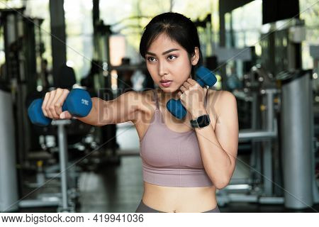 An Asian Women Exercise With Dumbbells For Boxing In Fitness Gym.  With A Boxing Dumbbell Workout Bo