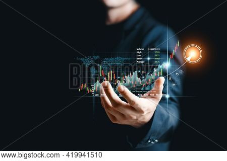 Businessman Analyze Sales Data And Graph Economic Growth. Planning And Business Strategy Analysis Of