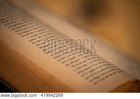 Closeup Photo of an Open Book. Cozy Evening with a Nice Novel at Home. Leisure Time with a Good Book. Home Schooling.