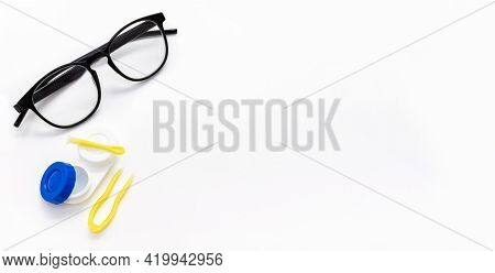 Glasses, Contact Lenses, Tweezers And An Applicator For Taking A Lens From A Case On A White. Optome