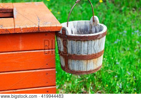 Wooden Bucket Of Water Well . Traditional Water Well In Village