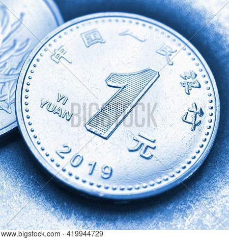 1 One Chinese Yuan Coin Close-up. Light Blue Tinted Square Illustration About The Economy, Business,