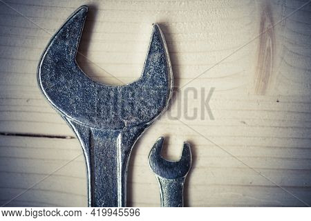 Metal Wrenches On A Wooden Background