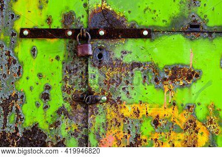 Old Green Rusty Metal Door With Lock.