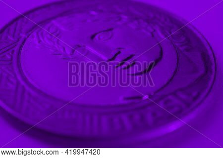 Brazilian 1 One Real Coin Close-up. Deep Violet Background Or Wallpaper. Reverse Of The Coin With Th