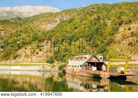 Beautiful Komani Lake With Shipwreck And Mountains With Forest, Northern Albania. The Theme Is Natur