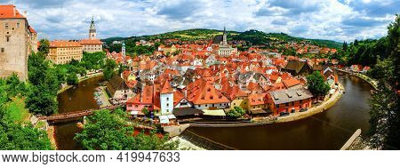 Panorama Of The Town Of Český Krumlov With The Moldau River, Chateau And Church.  Beautiful And Colo