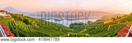 Panorama Town Of Cles With Fruit Sets And Lake Santa Giustina In The Valley Val Di Non In North Ital