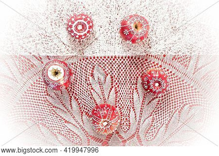 Beautiful Festive Ornament Of Apples. White (christmas) Decoration On Red Apples. Holiday Still Life
