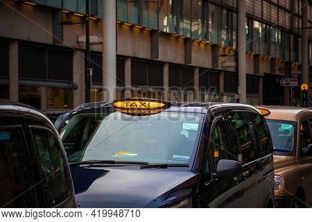 London, Uk - February 2, 2021 - London Black Cabs Queueing At A Taxi Rank Outside Kings Cross Statio
