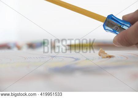 Pencil Sharpenerand Shavings On A White Background