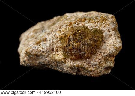 Macro Stone Grossular Mineral On A Black Background Close Up
