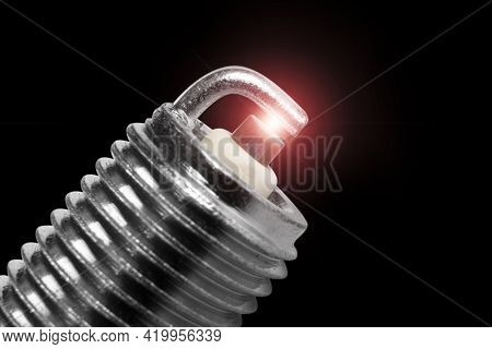 Macro Shot Of Sparks On Spark Plug Isolated On Black Background. A Spark Plug For An Engine Isolated