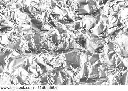 Close Up Of Aluminium Foil Crumpled. Silver Aluminium Foil Texture Background. Abstract Metallic Pap