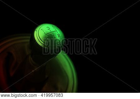 Close Up View Of A Gear Lever Shift. Manual Gearbox In Red And Green Lights. Car Interior Details. C