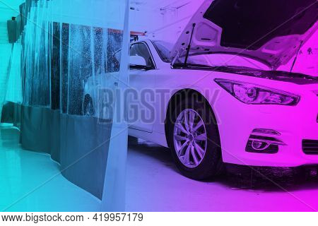 Cars In A Carwash In Blue And Pink Tones. Car Wash With Foam In Car Wash Station. Carwash. Washing M