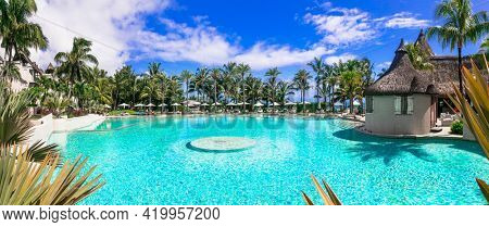 luxury 5 star resort territory with swimming pool and hotel rooms - Lux Bell mare resort. Mauritius island. Coastal Road, Belle Mare. 27.01.2020
