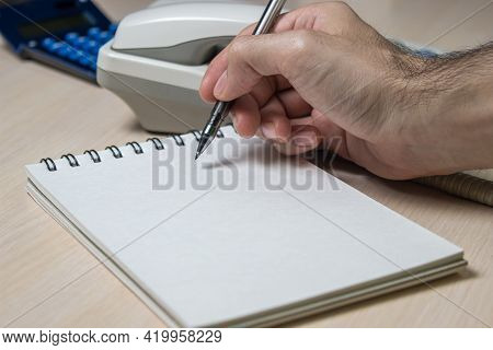 Office Work. Business Development Concept. Increased Sales. Sales Management. Hand Writes In Noteboo