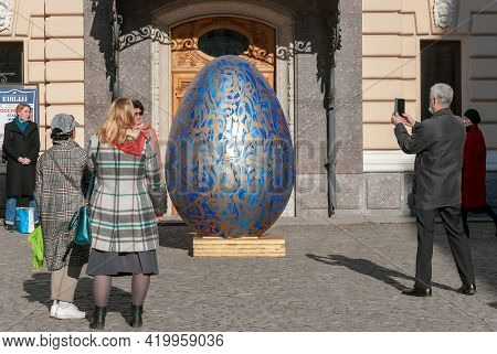 Saint-petersburg, Russia - May 9, 2021: People Take Pictures Of The Giant Painted Easter Egg Near Th
