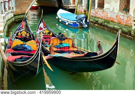 Venice, Italy  - June 18, 2018: Two gondolas close up  on  canal in Venice