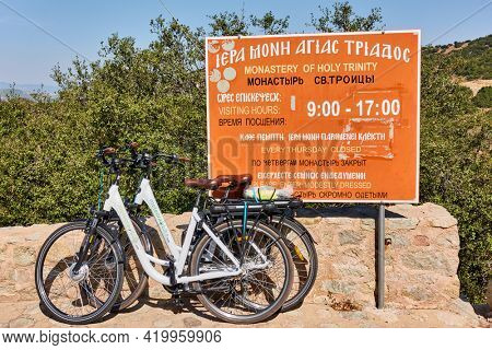 Meteora, Kalambaka, Greece - September 17, 2019:  Rented bicycles by the sign of Nonastery of Holy Trinity point in Meteora