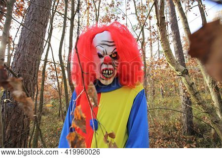 Halloween. Creepy Clown Halloween Costume.traditional Masquerade And Carnival In October.creepy Scar