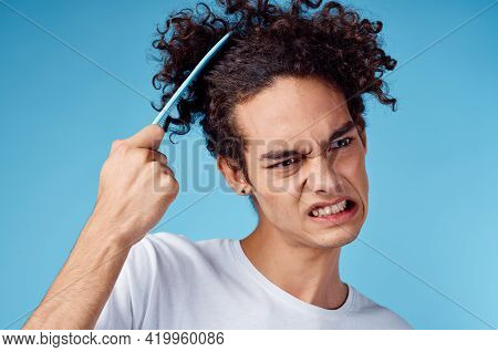 Problems With Combing Hair Young Guy In T-shirt And Combing Curls Model