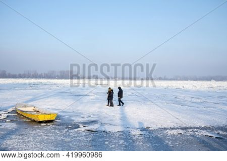 Belgrade, Serbia - January 21, 2017: Family Walking On The Frozen Danube During The 2017 Winter, In