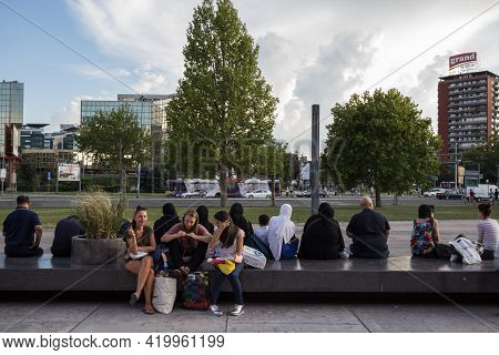 Belgrade, Serbia - July 26, 2018: Contrast Between Three European Girls, Friends, Sitting In Short A