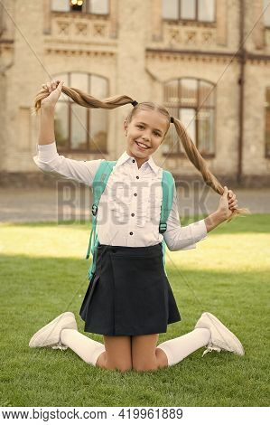 Long And Healthy. Happy Schoolchild Hold Long Blond Hair. Adorable Little Child Smile With Long Hair