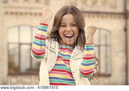 Focus On Happiness. Happy Childrens Day. Small Girl Has Curly Hair. Spring Kid Fashion. Little Beaut