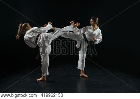 Female and male karate fighters, combat in action