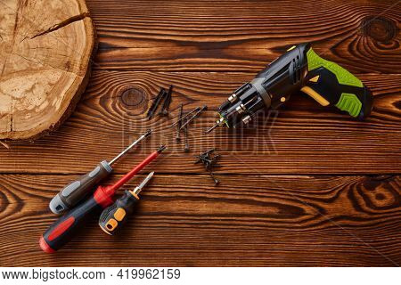 Screwdrivers and self tapping screws on stump