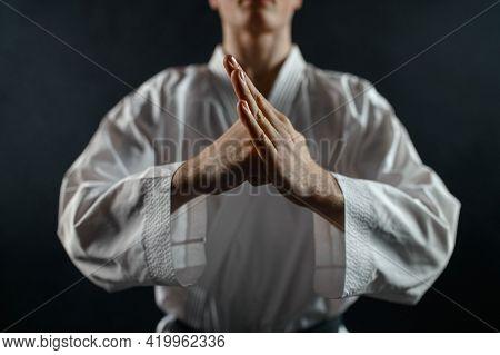 Male karate fighter in white kimono, welcome sign