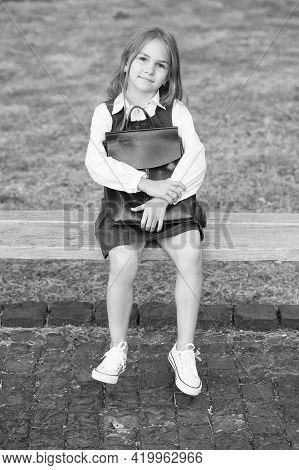 Educating Tiny Minds. Little Kid In Uniform Sit On Park Bench. School Fashion. Schoolwear. Elementar