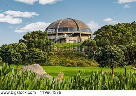 Nature Surrounding Dome Building, Front View Of Dome In The Morning Next To The Forest
