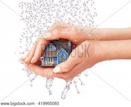 Save House. Hands Protecting House From Rain On A White Background.