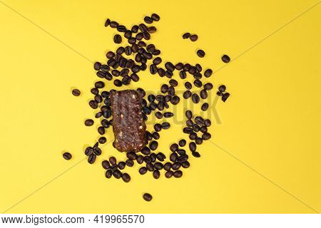 Energy Bar With Coffee Beans. Top On A Yellow Background. Sweet Snacks