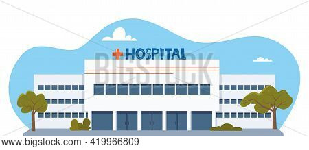 Hospital Clinic Building With Green Bushes And Benches At Front Yard. Medicine, City Infirmary Healt