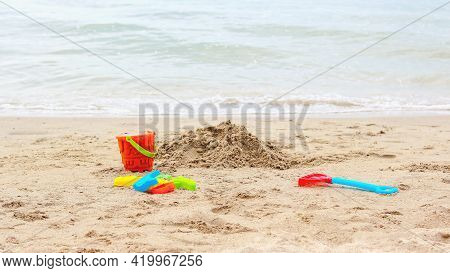 Bucket And Shovel Toy On The Beach.