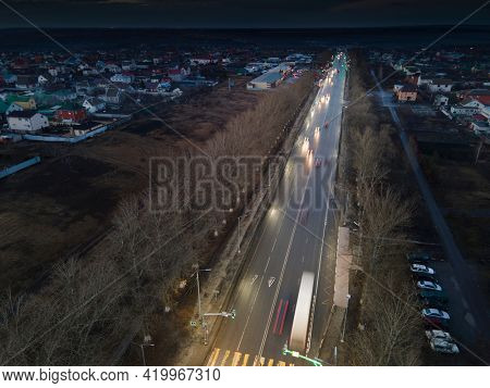 The car light trails in the city street Traffic. Top Down Aerial Drone view of a road at night