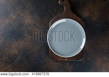 Empty Plate, Cutlery For Dinner Or Lunch Eat, Dark Table, Top View. Lunch Table Place Setting In Dar