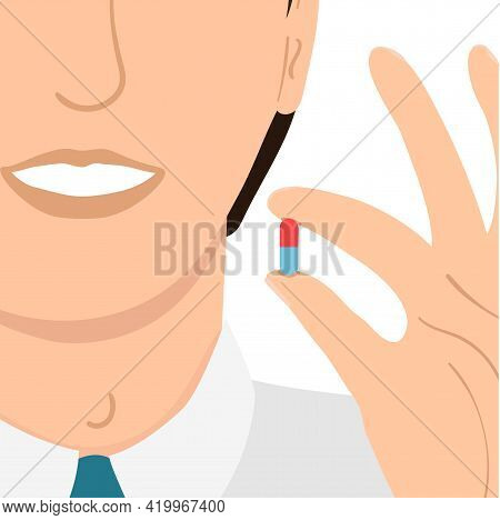 Young Man Drinks A Pill Isolated On White Background