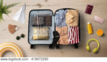 Flat Lay Top View Of Packed Suitcase And Travel Essentials, Summer Holiday, Coronavirus And New Norm