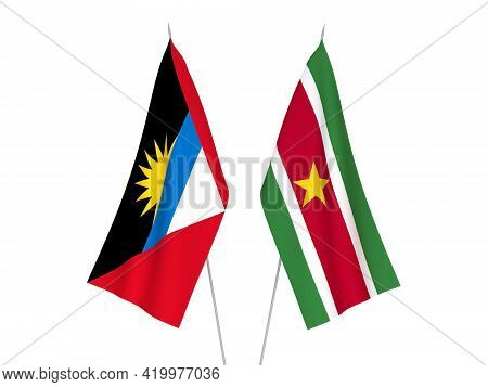 National Fabric Flags Of Antigua And Barbuda And Suriname Isolated On White Background. 3d Rendering
