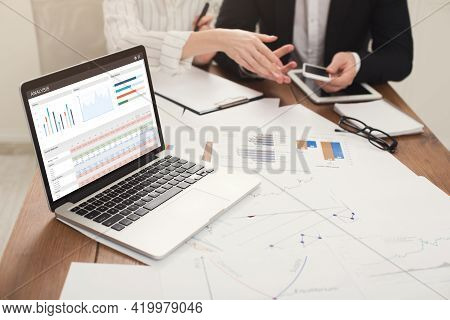 Business Team Making Business Prognosis, Using Laptop