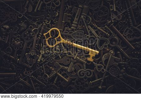 Unique gold key on pile of vintage skeleton keys. Concept for individual or uniqueness, unlocking potential, or stand out from the crowd.