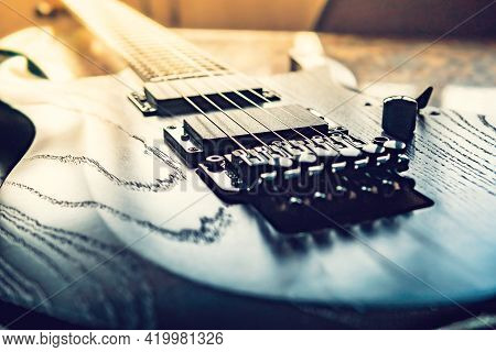 Closeup Of Wooden Electric Guitar With Six Strings, Selective Focus On Strings