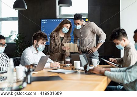 Colleagues Having Meeting In Boardroom, Businessman Giving Speech